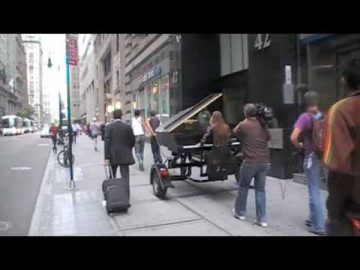 Iris & her flying piano in NYC